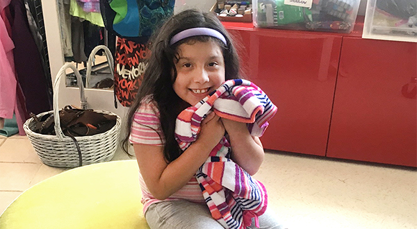 A happy child shopping at Clothes To Kids of Fairfield County