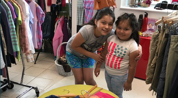 Two happy shoppers at the Clothes To Kids of Fairfield County Store!