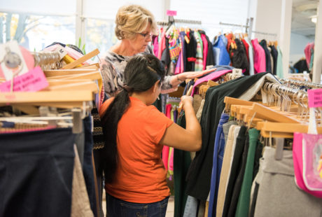 CTKF's Volunteer Coordinator Nadine Baccellieri assists a client as she shops for clothing for her children
